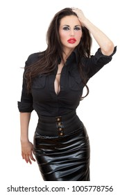 Attractive beautiful sexy young woman in a black fetish PVC miniskirt and blouse shirt showing cleavage isolated on white background