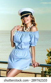 Attractive beautiful woman in captain hat