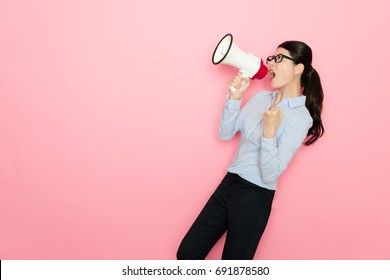 attractive beauty girl office leader using loudspeaker speaking and cheer up to encourage employee hard work isolated on pink background.