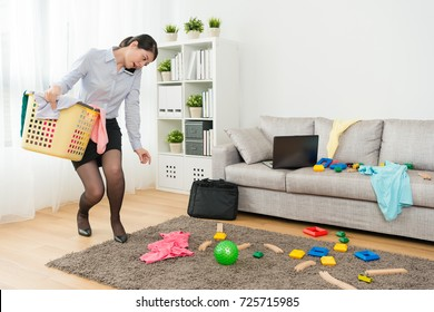 attractive beauty lady office work using mobile smartphone call and talking when she back to home put mess living room in order.