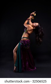 Attractive bellydancer performing with zills on her fingers