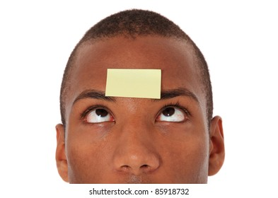Attractive black with blank post-it note on his forehead. All on white background.