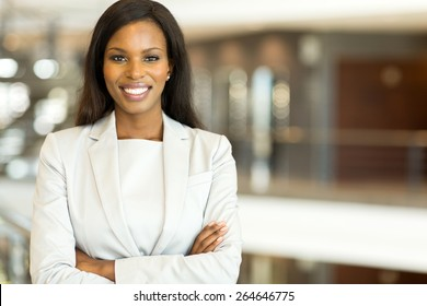 attractive black business executive with arms crossed