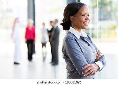 attractive black businesswoman looking outside window