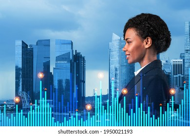 Attractive black businesswoman in suit pondering about new approaches to consultancy to find priorities for venture capital start up to estimate prospective growth. Financial chart on Singapore.