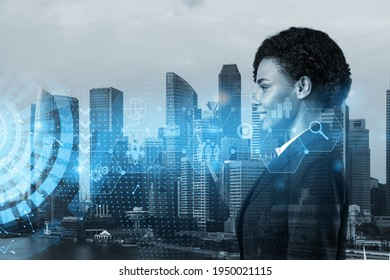 Attractive black businesswoman in suit thinking about career opportunities at research and development department at international company. Hologram icons over Singapore background.