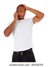 Attractive black man gets shocking news during phone call. All on white background.