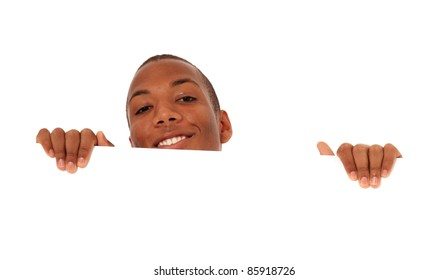 Attractive black man hiding behind white wall. All on white background.