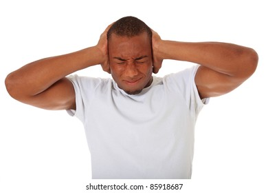Attractive black man keeps his ears shut. All on white background.
