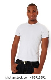 Attractive black man leaning to wall. All on white background.