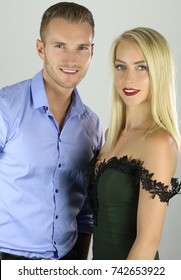 Attractive blond couple posing