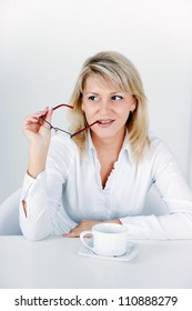 attractive blond girl with a cup of tea in the office
