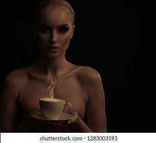 Attractive blond lady holding coffee cup