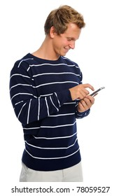 Attractive blond male holds his mobile phone and types out a text message