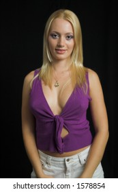 Attractive blond model on black background - very high resolution - violet top