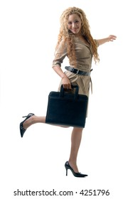 attractive blond wearing a khaki colored dress carrying a black portfolio standing on one foot on white