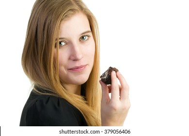 An attractive blond woman eating chocolate cake
