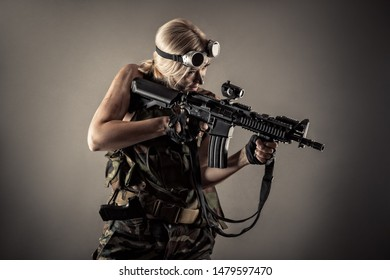 attractive blond woman with gun in hands