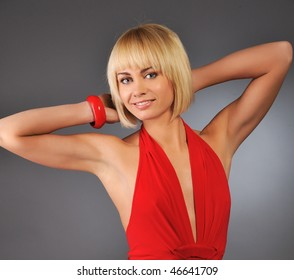 Attractive blond woman isolated on grey background