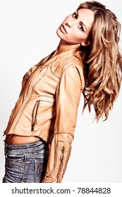 attractive blond woman in leather jacket, studio shot