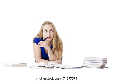 Attractive, blond woman lying at floor with books thinks about exam. Isolated on white background.