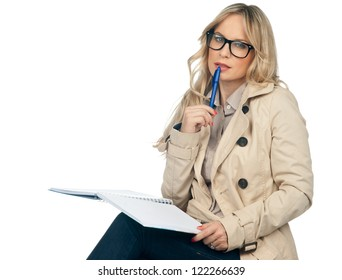attractive blond woman with notebook thinking