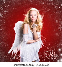 attractive blonde angel and snowflakes with christmas background
