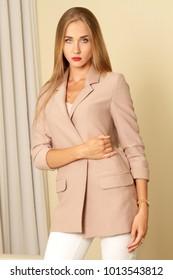 Attractive blonde business woman in suit portrait