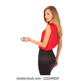 Attractive blonde with credit card in hand studio