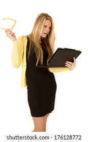 attractive blonde female holding glasses and tablet