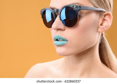 Attractive blonde girl with blue lipstick