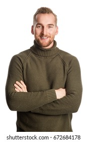 Attractive blonde man standing against a white background wearing a green turtle neck shirt looking at camera.
