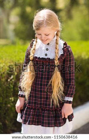 Attractive Blonde Schoolgirl With Long Hair