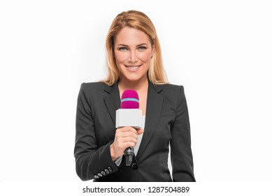 Attractive blonde TV presenter on white background holding a microphone and points to an object.