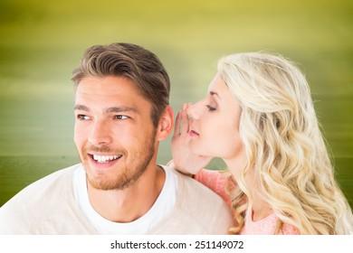 Attractive blonde whispering secret to boyfriend against wooden planks background