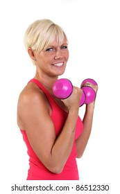 Attractive blonde woman doing bicep curls with colorful dumbbells