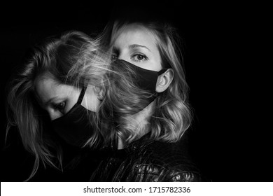attractive blonde woman face black mask. Dark mood background. environmental disaster polluted air. Virus protection covid corona Long exposure creative artistic black and white double portrait Badass
