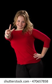 Attractive blonde woman, smiling and giving a peace sign with her fingers