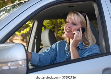 Attractive Blonde Woman Using Cell Phone While Driving