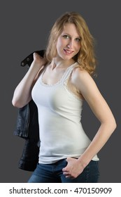 An attractive blonde woman wearing a white shirt and a leather jacket