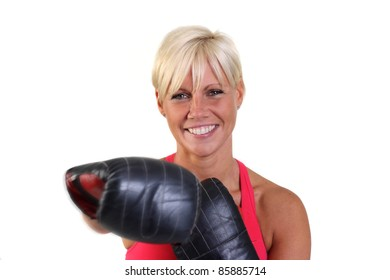 Attractive blonde woman working-out with sparring gloves. Motion and blur.