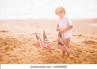 Attractive boy with American Flag on the beach after loosing his first tooth