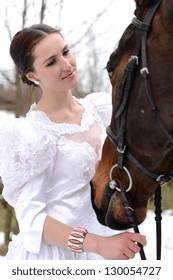 Attractive bride with horse