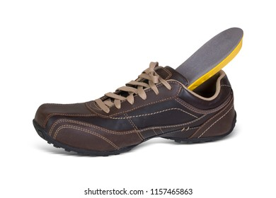 Attractive brown men leather shoes with light brown laces and shoe insole come out of the shoe. Perfect option to fit your shoes with insole.
