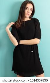 Attractive brunette businesswoman portrait on blue background