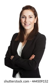 An attractive brunette businesswoman wearing a black suit and white shirt, standing with her arms crossed against white background.