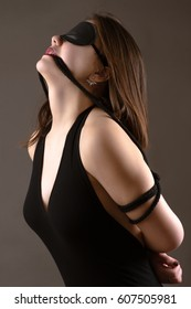 attractive brunette girl with blindfold on eyes