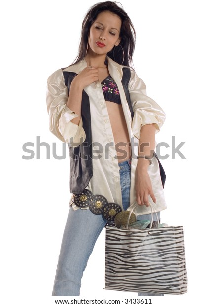 Attractive brunette girl holding bag  at shopping action