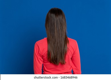 Attractive brunette girl in studio on a blue background