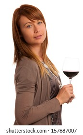 Attractive brunette with a glass of wine over white background